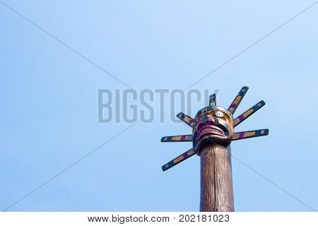 Totem Pole in Canada blue sky background