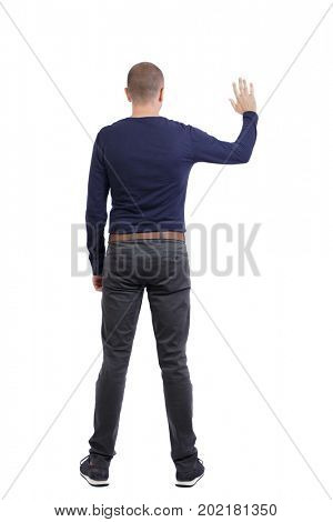 Back view of beautiful business man welcomes.  Young businessman in suit. Rear view  people collection.  Isolated over white background.A man in black trousers and sneakers gives a welcoming gesture.