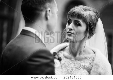 Close-up Photo Of A Wedding Couple Looking Into Each Other's Eyes. Black And White Photo.