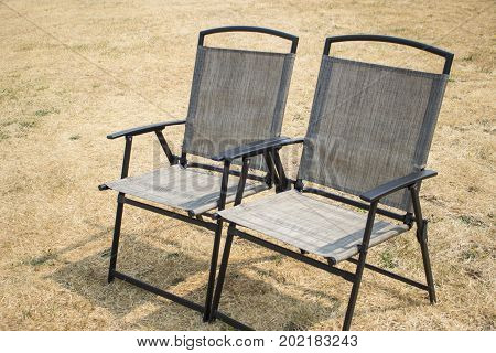 Brown outdoor folding chairs on the lawn