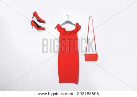 female red sundress on hanging with bag,.red shoes isolated