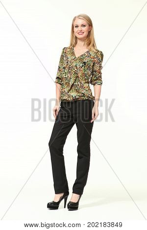blond business woman in half length sleeve print blouse and black trousers  high heeled shoes full body portrait isolated on white