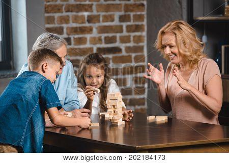 Family Playing Blocks Wood Game