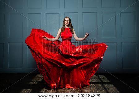 Beautiful Fashion Model Woman in Red Silky Dress. Beautiful Woman Full Portrait