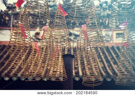 Close up on burning incense coils in Chinese Temple