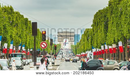 Street Atmosphere On The Avenue Des Champs Elysees