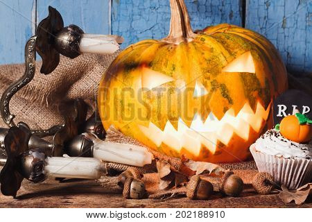 Halloween Pumpkin And Cupcakes With Colored Decorations