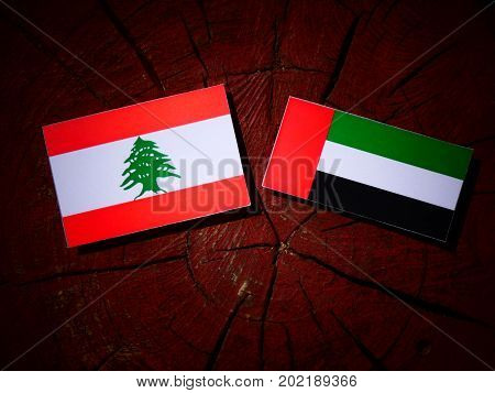 Lebanese Flag With United Arab Emirates Flag On A Tree Stump Isolated