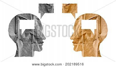 Crumpled paper shaped as a human heads and talk balloons on white background. Conversation dialogue and opinion concept.