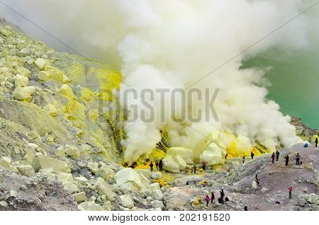 Mining Pure Sulfur in the Smoking Crater of Mt. Ijen, East java, Indonesia.