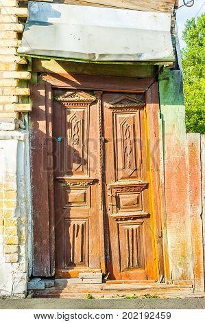 Kiev/Ukraine - July 01 2006 - Entrance door of an old abandonned house in Kiev Ukraine