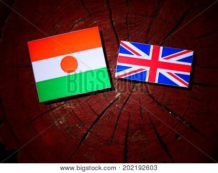 Niger Flag With British Flag On A Tree Stump Isolated