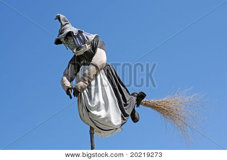 witch on a broomstick against blue sky