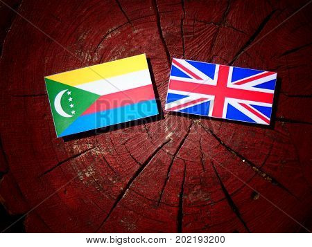 Comoros Flag With British Flag On A Tree Stump Isolated