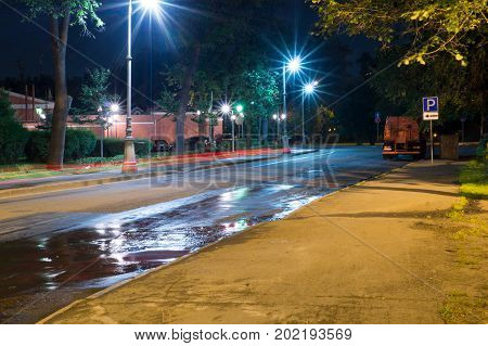 quiet city street with lights at night. background city life
