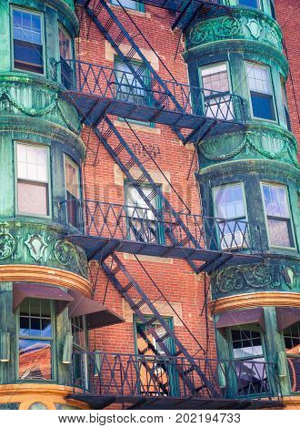 Fire escapes on a brick building in Boston