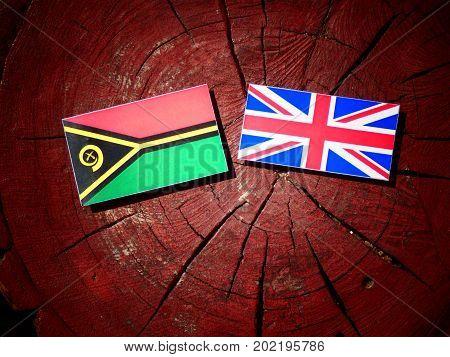 Vanuatu Flag With British Flag On A Tree Stump Isolated