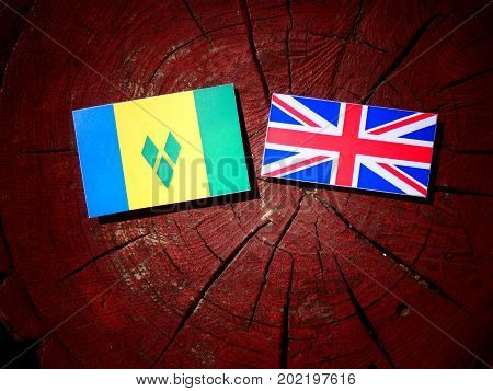 Saint Vincent And The Grenadines Flag With British Flag On A Tree Stump Isolated