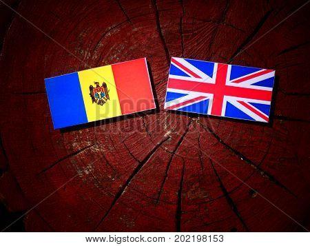 Moldovan Flag With British Flag On A Tree Stump Isolated