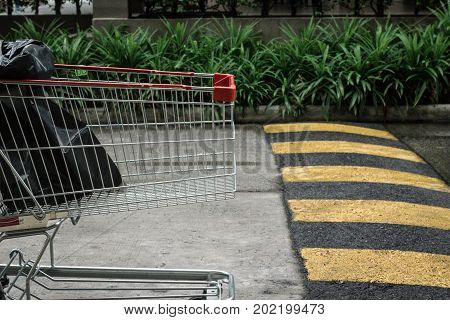 Cart crossing speed bump on the road.