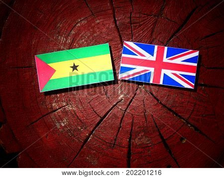 Sao Tome And Principe Flag With British Flag On A Tree Stump Isolated