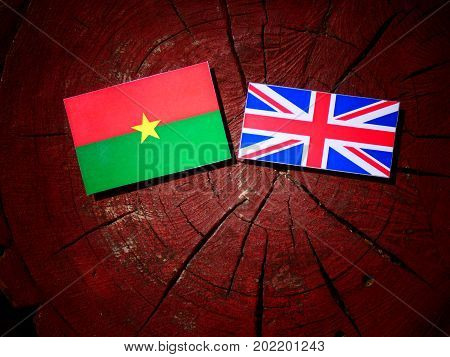 Burkina Faso Flag With British Flag On A Tree Stump Isolated