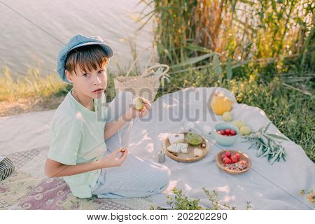 a boy on the river bank under the shining sun