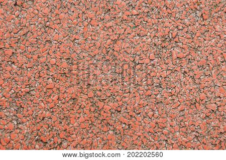Seamless texture of a coating of crumbs of bright red decorative stones