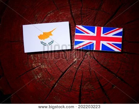 Cypriot Flag With British Flag On A Tree Stump Isolated