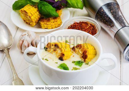 Cream soup with slices of corn grill. Studio Photo