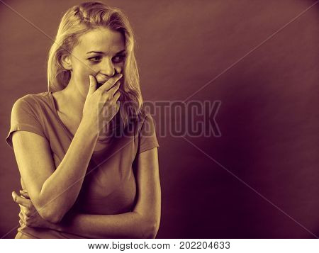 Tiredness bed time concept. Sleepy tired yawning woman covering mouth with hand