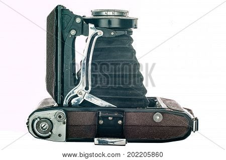 A vintage camera isolated on white background.