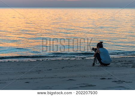 Women nature photographer,Female photographer taking pictures of the beautiful beach and blue sky