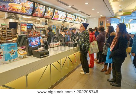 HONG KONG - JANUARY 27, 2016: counter service in a McDonald's restaurant. McDonald's is an American hamburger and fast food restaurant chain.