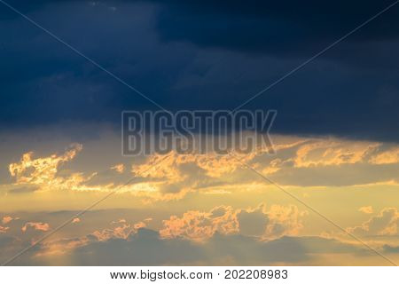 Dark Clouds Overlook A Beautiful And Warm Sunset