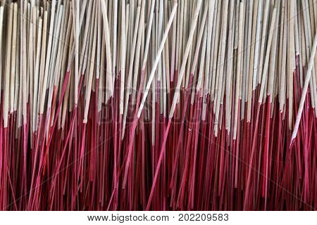 Incense have red stalk for the worship of a large number of Buddha placed stacked.