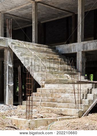 Unfinished concrete staircase of the large church in the under constructionThailand.