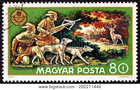 HUNGARY - CIRCA 1971: a stamp printed in Hungary shows Deer Hunt World Hunting Exhibition Budapest circa 1971
