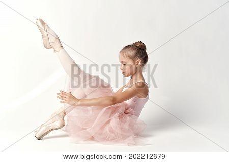 child, girl ballerina on a white background.