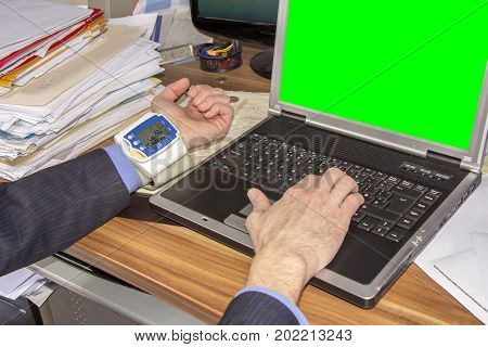 Businessman with high blood pressure due to stress caused by the decline in investment on green screen