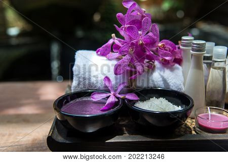 Thai Spa Treatments aroma therapy salt and sugar scrub and rock massage with orchid flower. Healthy Concept. copy spaceselect and soft focus