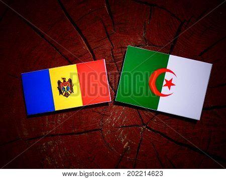 Moldovan Flag With Algerian Flag On A Tree Stump Isolated