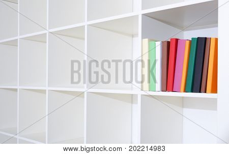 Empty bookshelf. White shelving