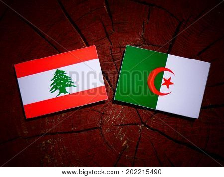 Lebanese Flag With Algerian Flag On A Tree Stump Isolated