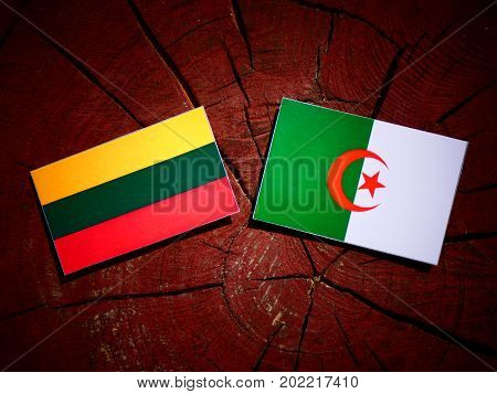 Lithuanian Flag With Algerian Flag On A Tree Stump Isolated