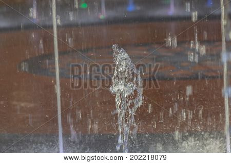 Fountains water stream splashing on ground for background