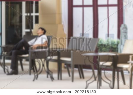 Defocus blurred young man sleep on chair