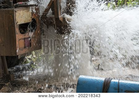 Drill rig to a water well for crop irrigation