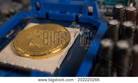 Bitcoin on the motherboard. Crypto currency Gold Bitcoin - BTC - Bit Coin