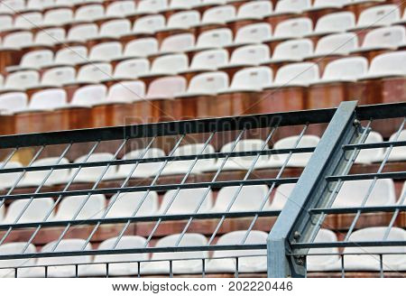 Robust Metal Mesh In The Stadium To Divide The Fans On The Stair